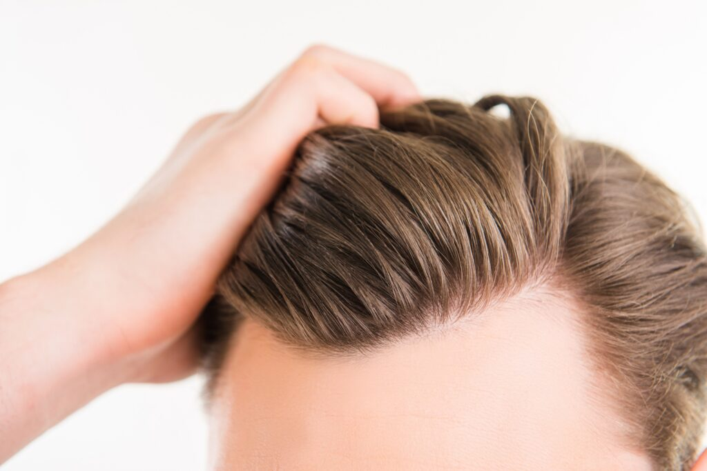 Close up photo of clean healthy man's hair without furfur